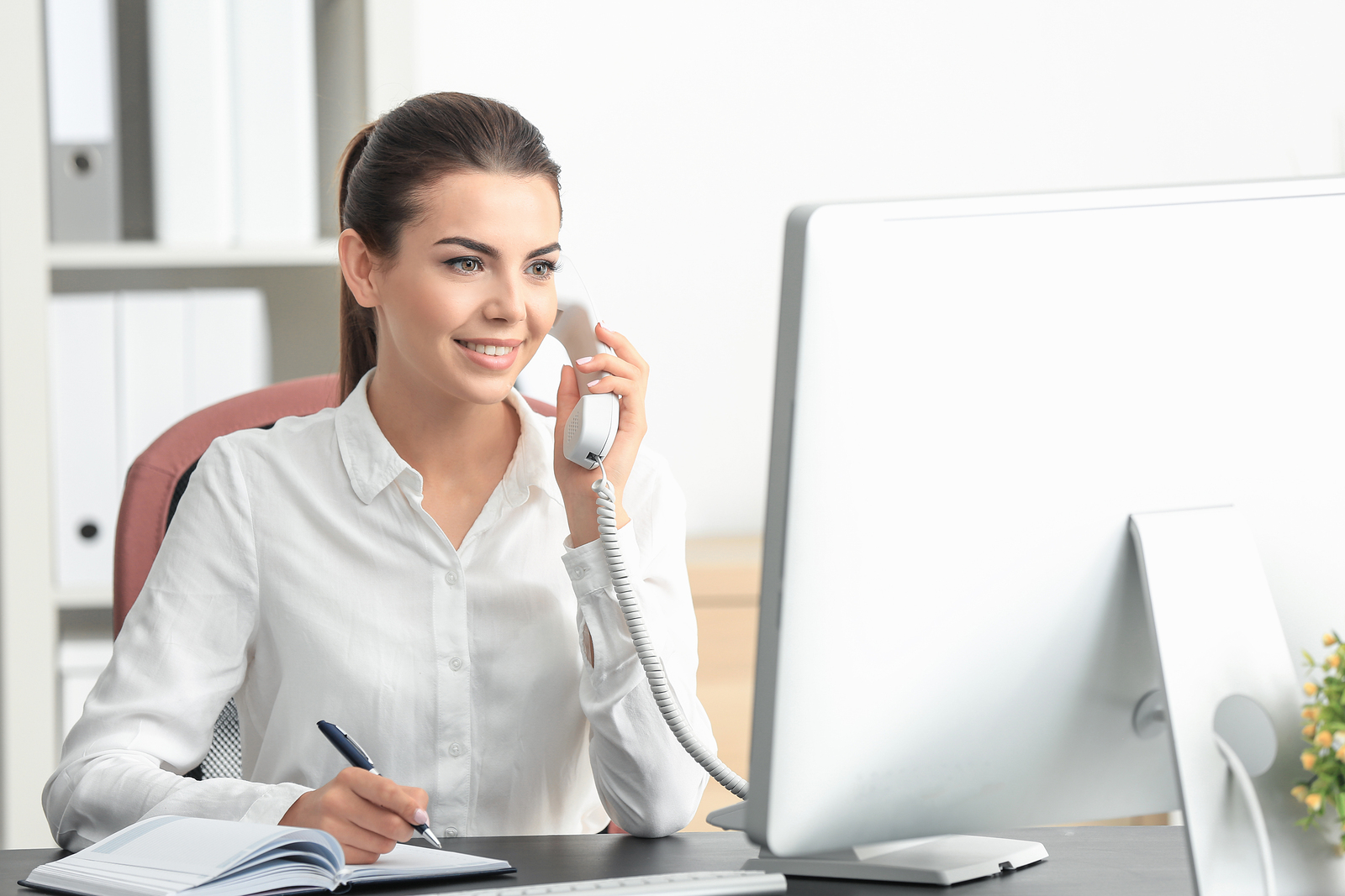 Receptionists at law firms have the daunting task of compiling many dozens of messages every day, making sure the lawyer and his associates receive them.  ©BigStockPhoto