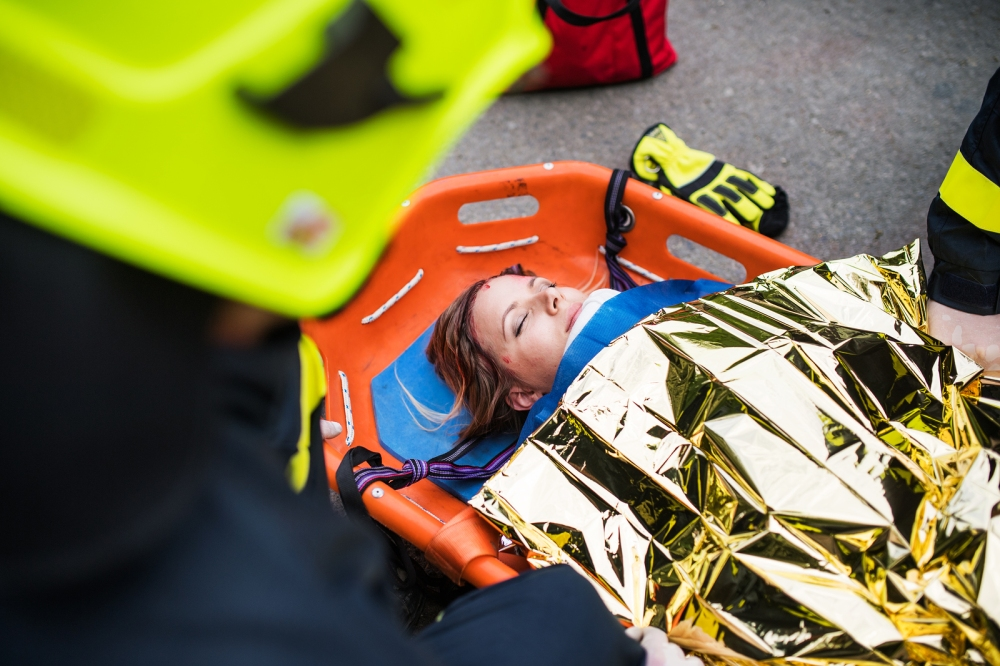 An Injured Woman In A Plastic Stretcher After A Car Accident, Co