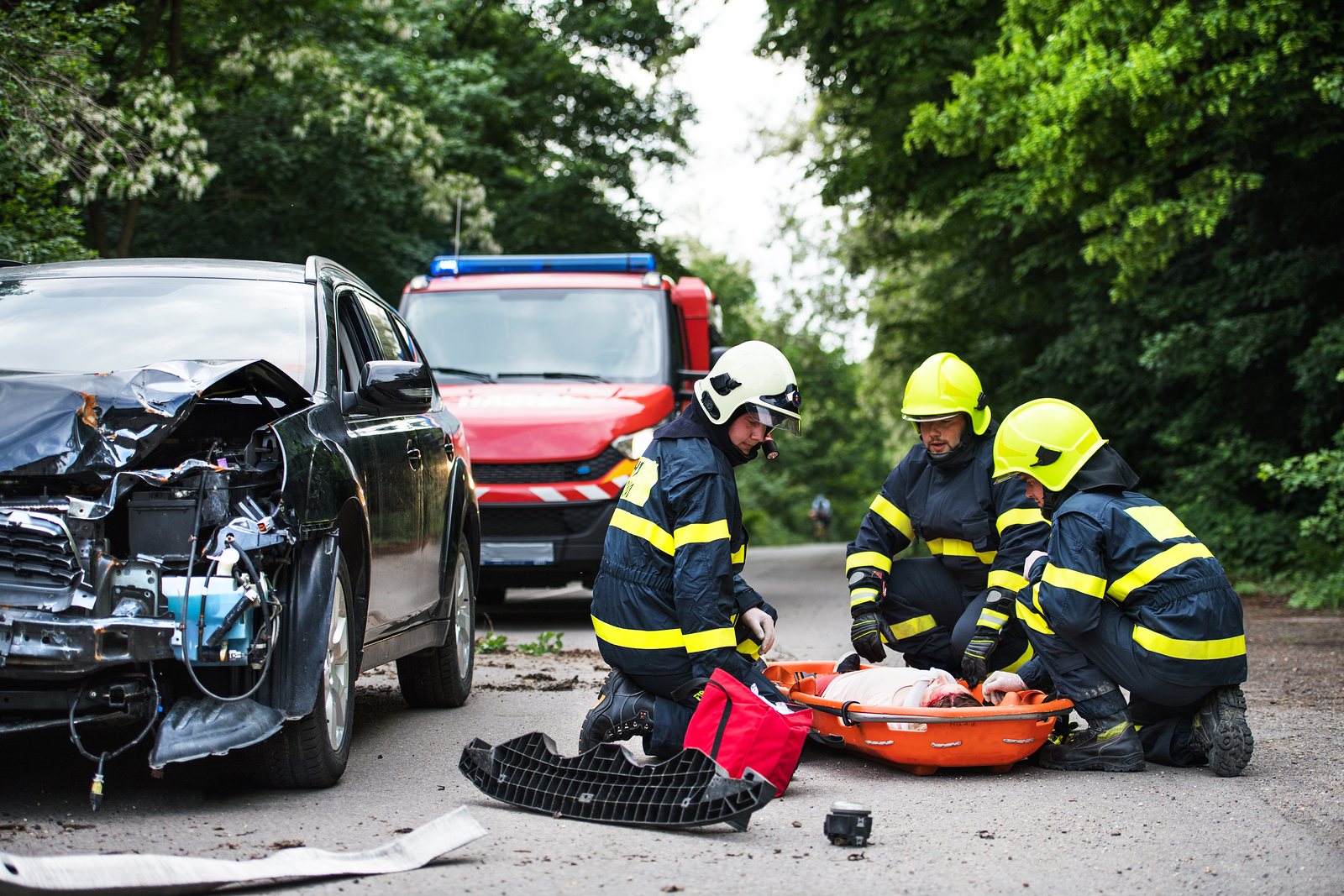 Firefighters Helping A Young Injured Woman After A Car Accident.